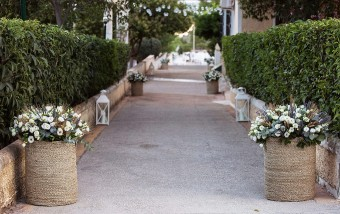 Flower baskets along the way Wedding in Greece